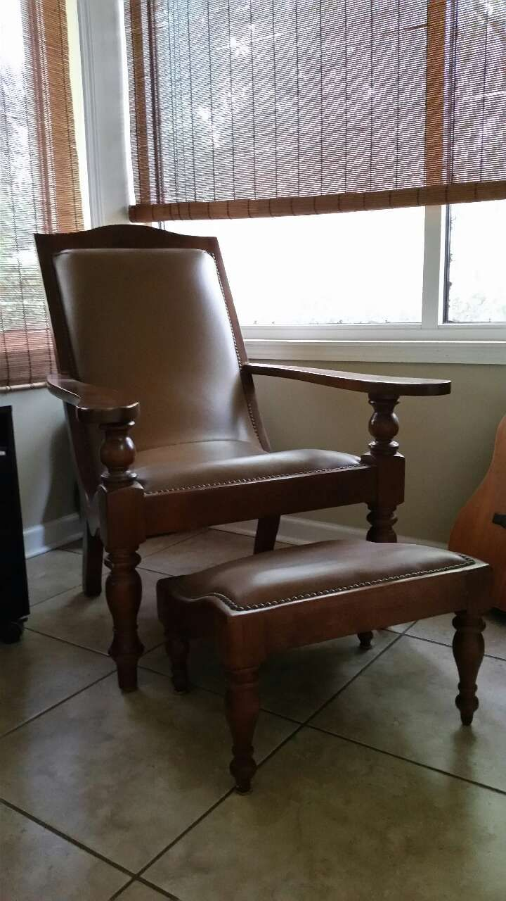 Used leather chair with footstool for sale in Jacksonville