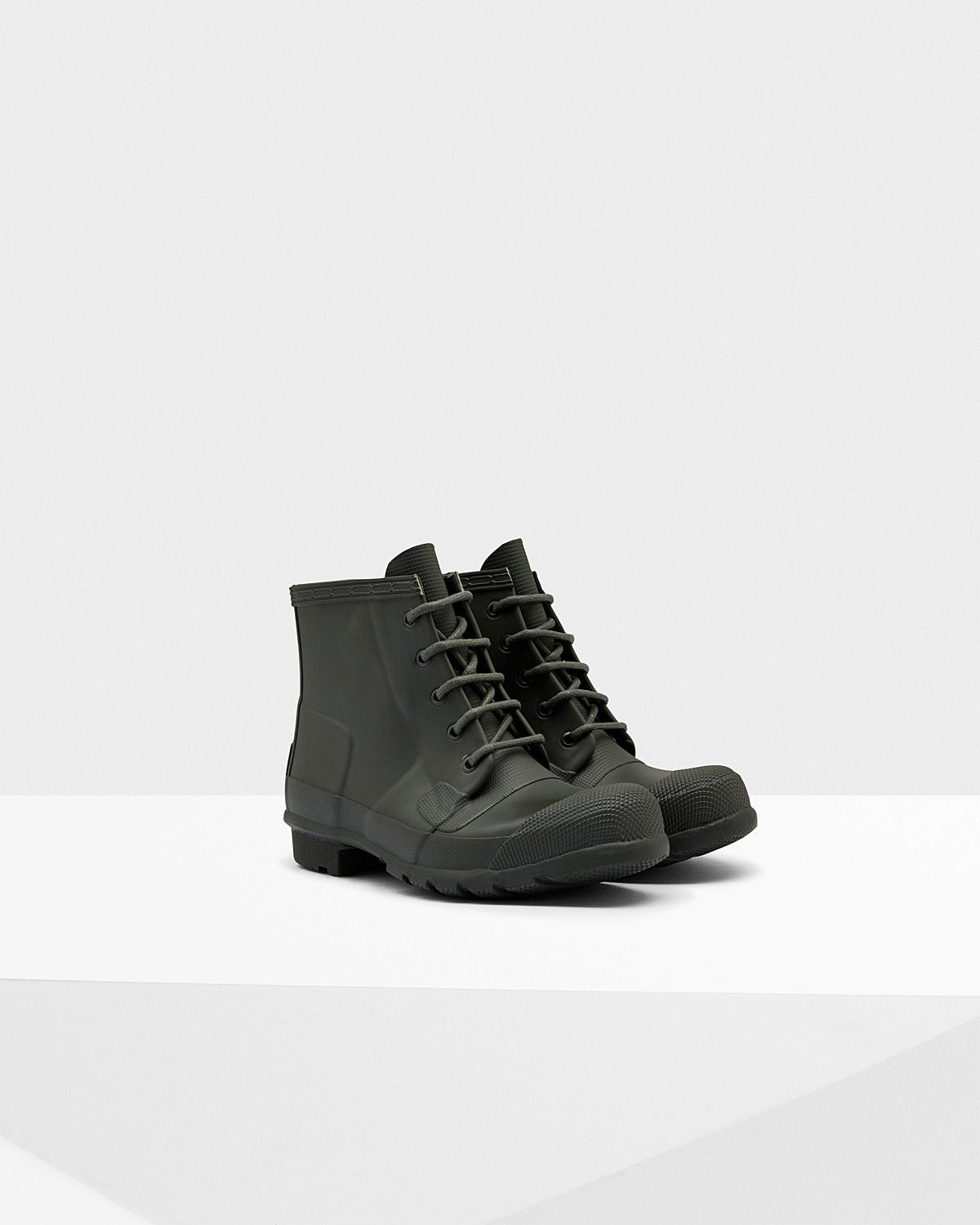 A lace-up, waterproof ankle boot in matte rubber.