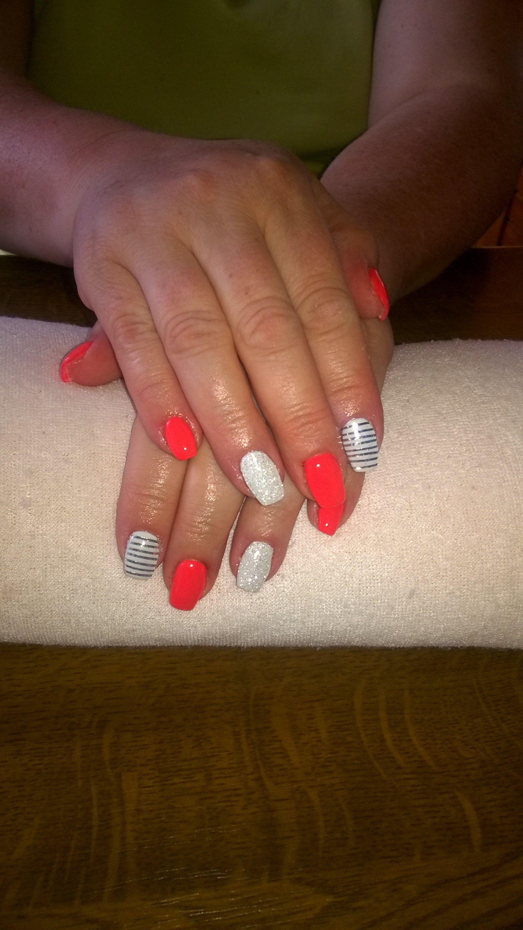 neon orange gel, white glitter and silver stripes