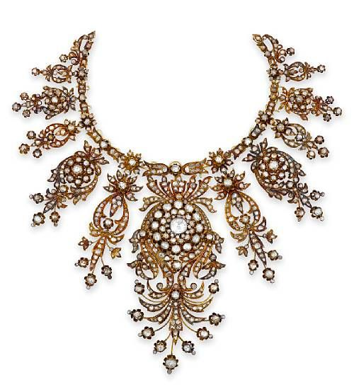 An antique diamond necklace, circa 1880 designed as elaborate graduated openwork sections of rose-cut diamonds in a floral motif, completed by a (later) gold backchain