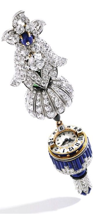 Platinum, 18 Karat Gold, Diamond, Jadeite, Lapis Lazuli, Pearl and Enamel 'Stalactite' Lapel-Watch, Cartier The floral top centered by an old European-cut diamond weighing approximately .85 carat, suspending a pendant which opens to reveal a watch dial, topped by a jadeite bead measuring approximately 10.3 mm, accented by a pearl, decorated throughout with lapis lazuli segments and highlighted with black enamel, set throughout with old European and single-cut diamonds7; circa 1925.