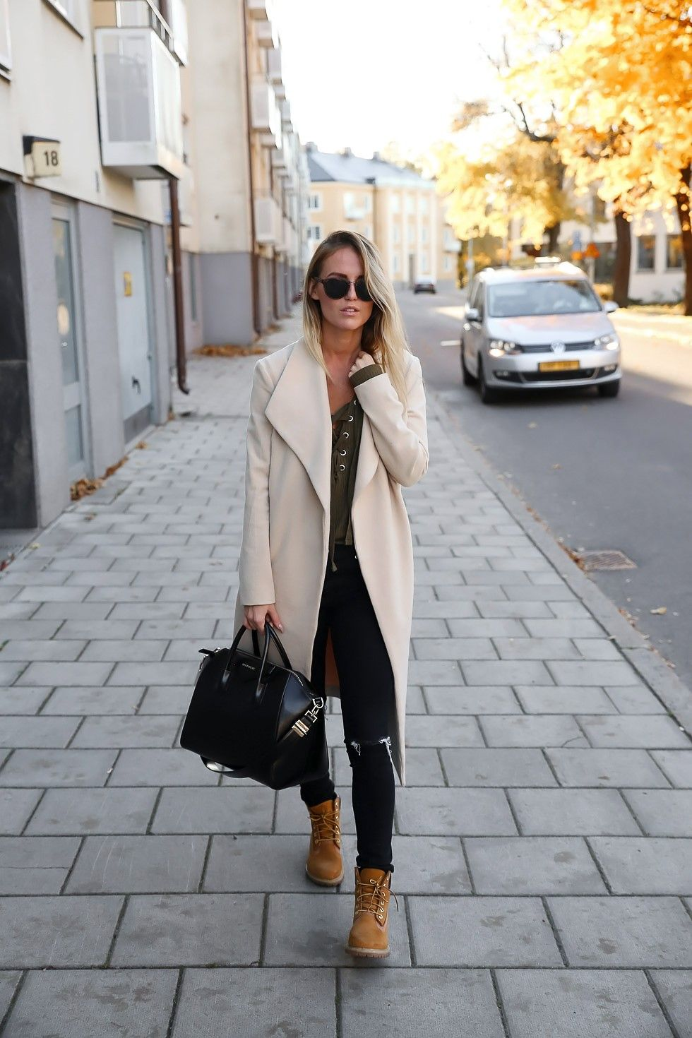 If you re wondering how to style Timberland outfits, try stealing Kristin  Sundberg s style by wearing the classic tan coloured boots with ripped  jeans and a ... a312952b2dc6