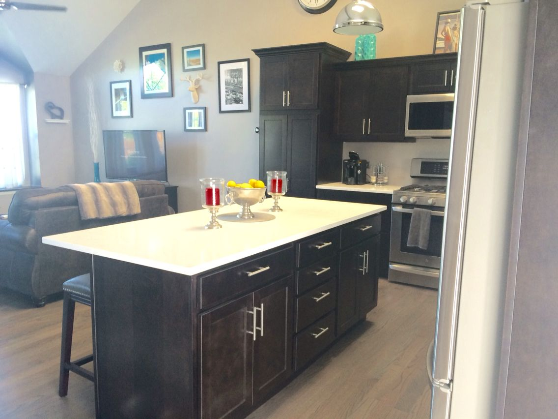 small spaces open concept kitchen and living room dark java cabinets with white and gray. Black Bedroom Furniture Sets. Home Design Ideas