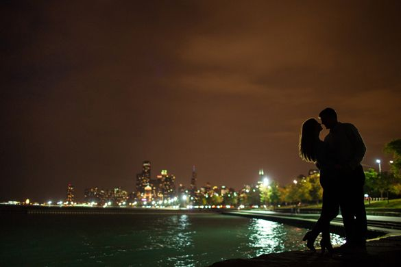Sihlouetted engagement photo on lake michigan at night