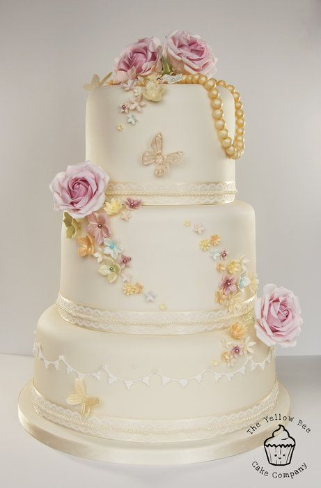 Three Tiered Beautiful Vintage Themed Wedding Cake With Butterlies Pearls And Roses