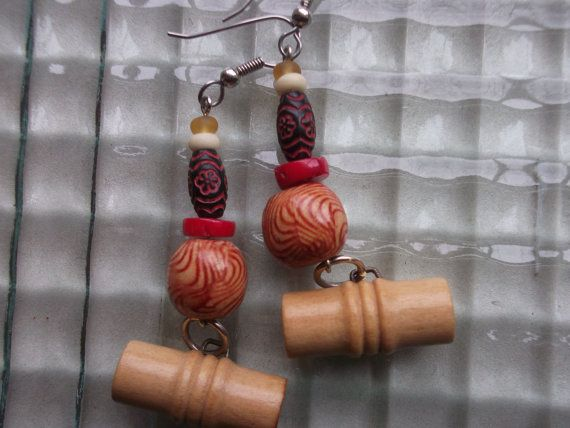 Vintage wood buttons and a mix of wood, red coral, bone and glass beads blend together in this primitive style earring.  Great for casual wear, spring, summer or fall!