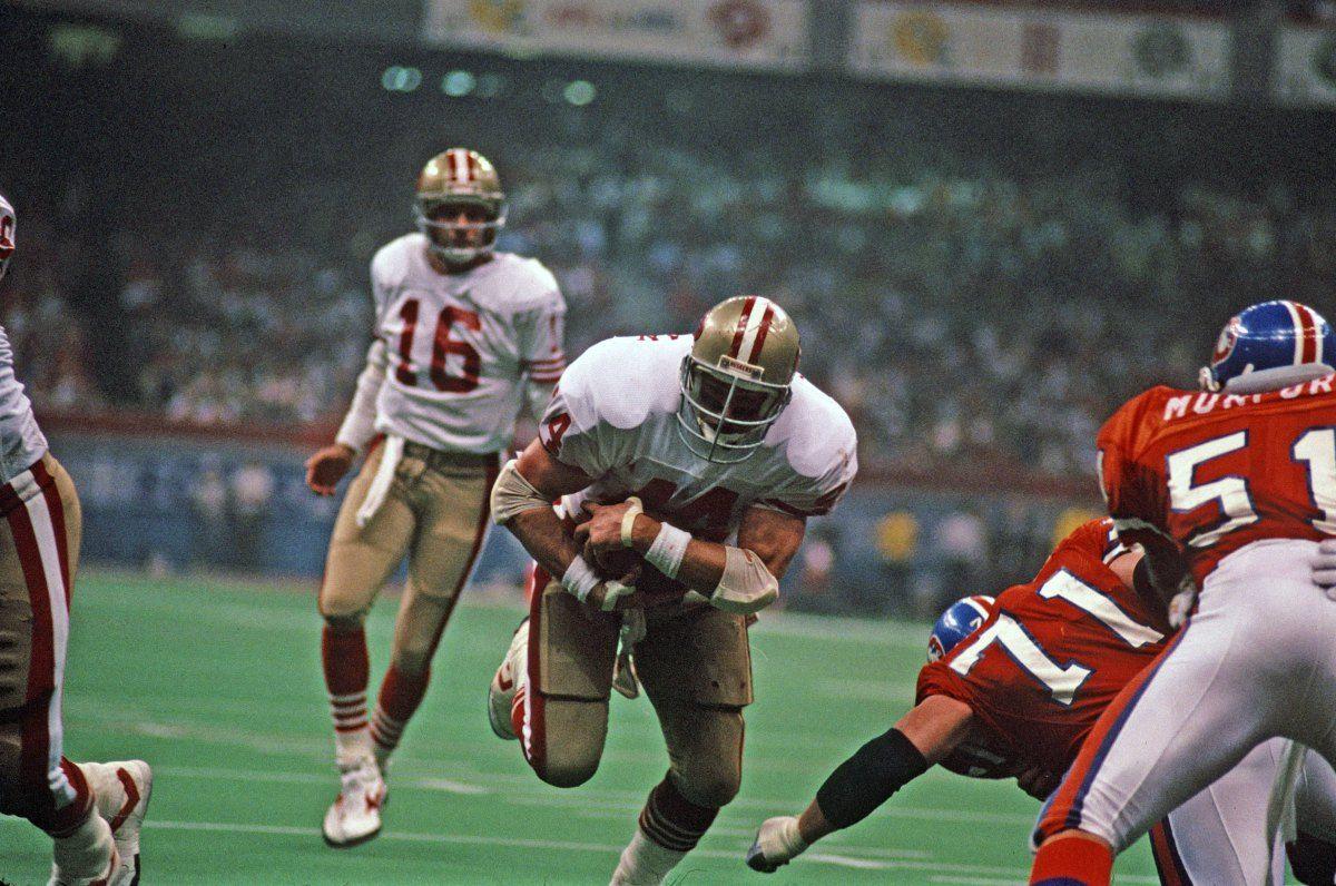 Tom Rathman (#44) and Joe Montana (#16) 49ers