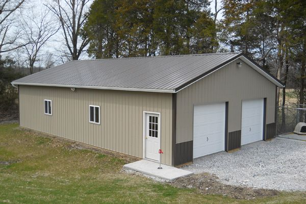 Pole building garage building kits steel building for Residential pole barn kits