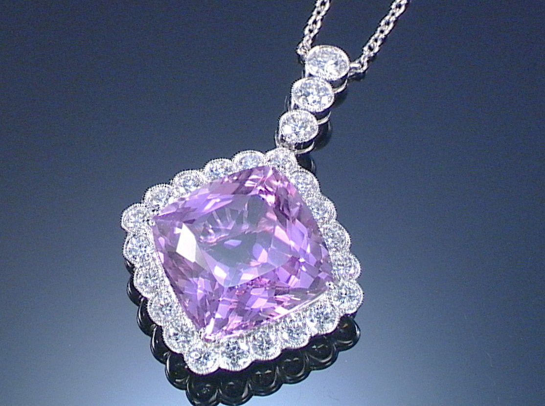 Kunzite and diamond pendant necklace centring on a mixedcut cushion