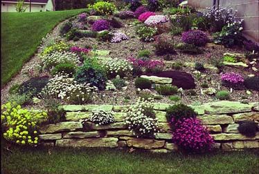 Knee walls tame a steep slope low walls at the bottom of a for Hillside rock garden designs