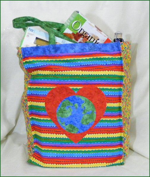 Free pattern - Loving Our Earth Reusable Grocery Bag with two side pockets for bottles. http://www.victorianaquiltdesigns.com/VictorianaQuilters/PatternPage/LovingOurEarth/LovingOurEarthGroceryBag.htm #reusablegrocerybag #fabric #ecofriendly