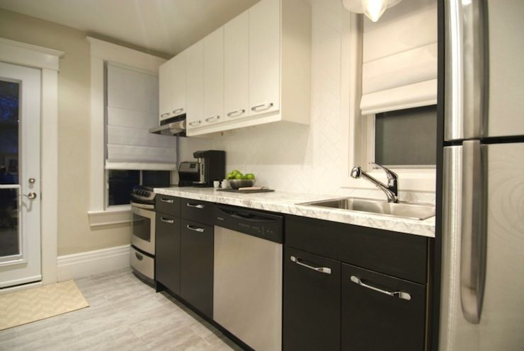 Property Brothers   Contemporary Kitchen Design With Two Tone Cabinets:  White Upper Cabinets And Black Lower Cabinets Paired With Formica® Laminate  Bianco ...