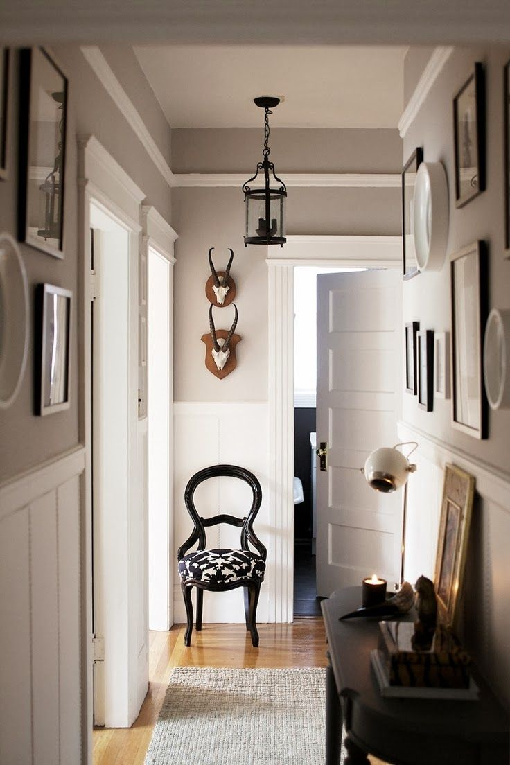 Beautiful details (molding, panels, light fixture, gallery wall, paint colors).