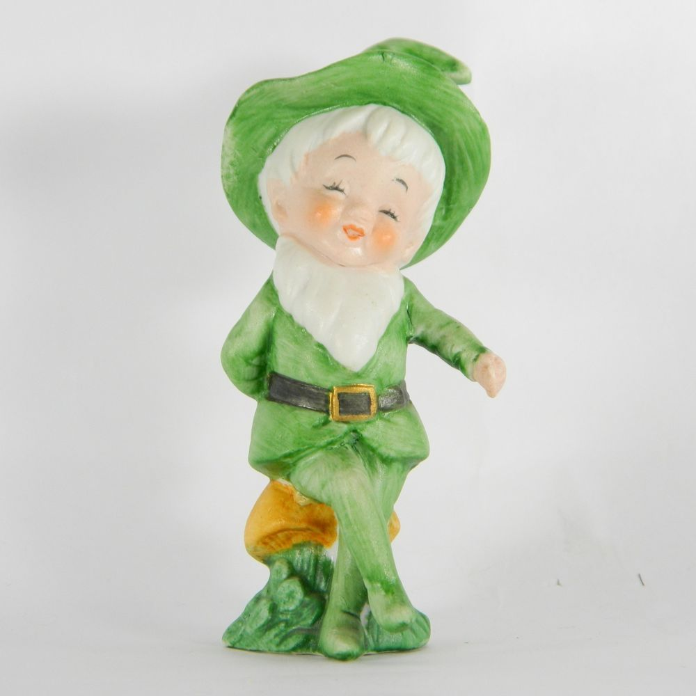 sold sitting figurine of an gnome pixie elf or leprechaun with