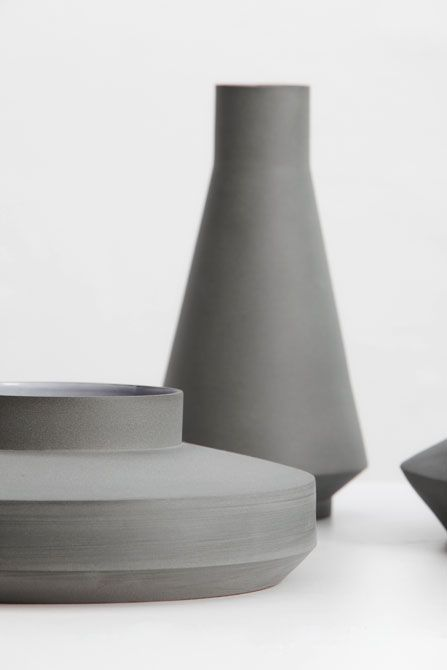 Concrete Vases. Not sure what I would do with these, but I very mush like the shapes and textures.