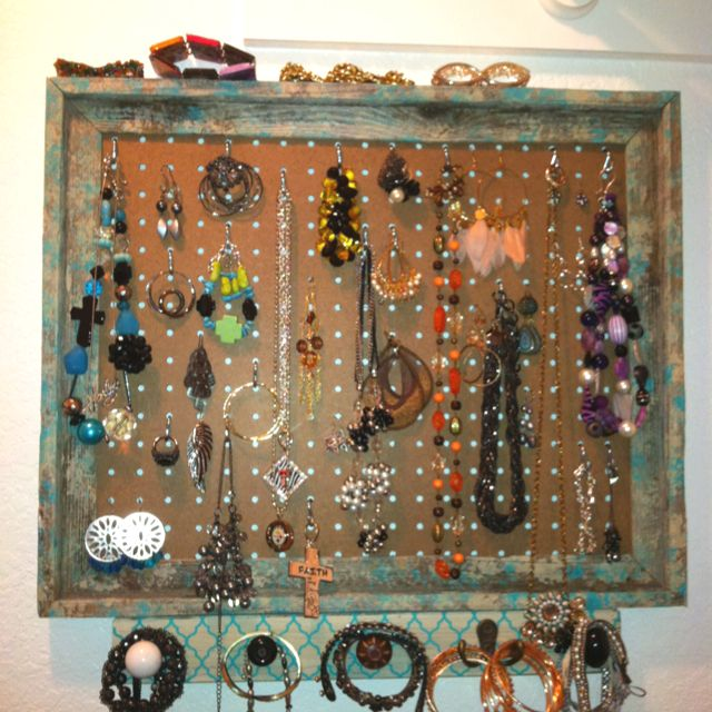 Jewelry holder made from an open wood frame Painted it attached