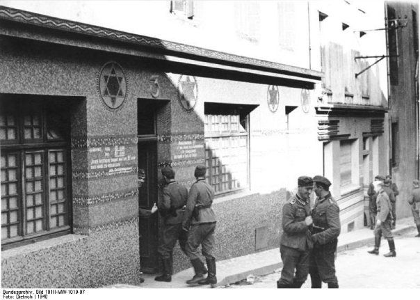 German soldiers enter a French synagogue turned into a German brothel.
