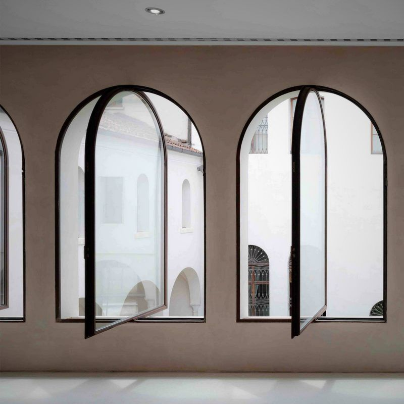 Black Steel Framed Windows With Arched Heads Steel Frame Doors Window Design Arch Interior