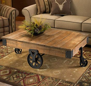 Hand Crafted Plank Style Table With Wheels Has The Look