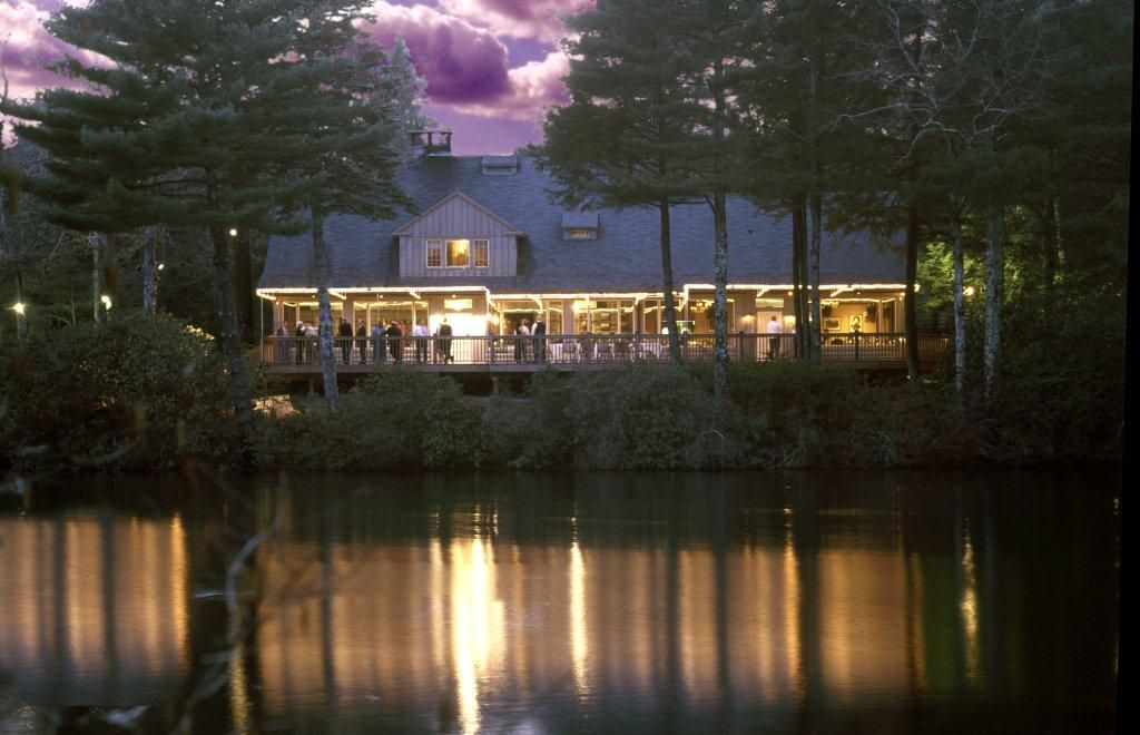 The Main Lodge Lit Up At Night Whispering Pines Conference Center Venue