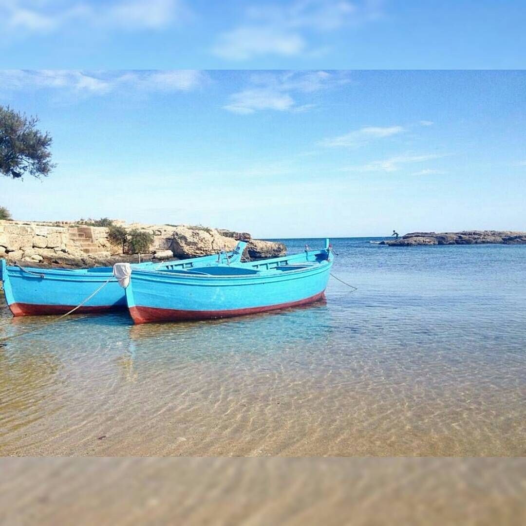 In the small bays of the coast of Savelletri there are small boats ...