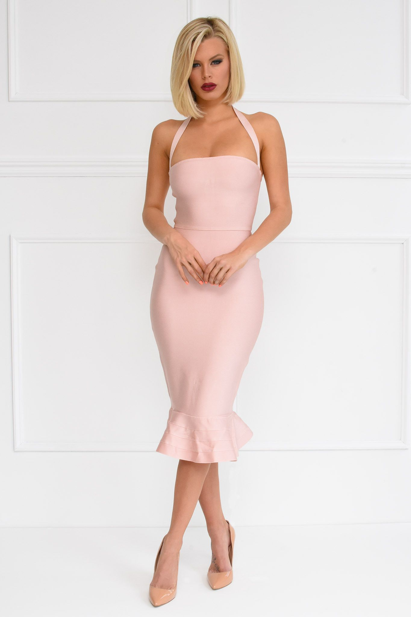 781f04f3d6b4 Front of blush pink bandage below knee bodycon dress with halterneck straps  and peplum ruffle fluted hem design