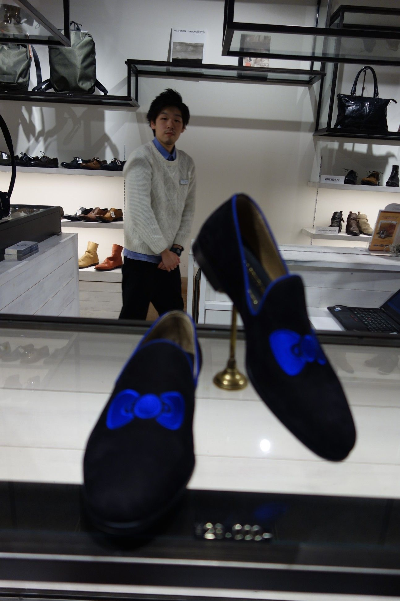 Hello Kitty's mens fashion line  The blue bow: priceless. Only 3 pairs in the world in size 28.