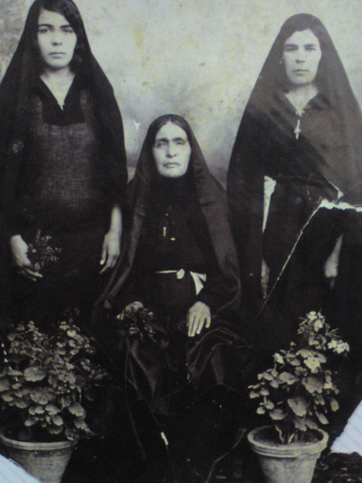in the right side av picture is my grandma  Beyghom agha and  in the left her sister Sadaat,,,and there,s mamma,she was my  pappas grand ma,,Sakineh,,,year1900-1905