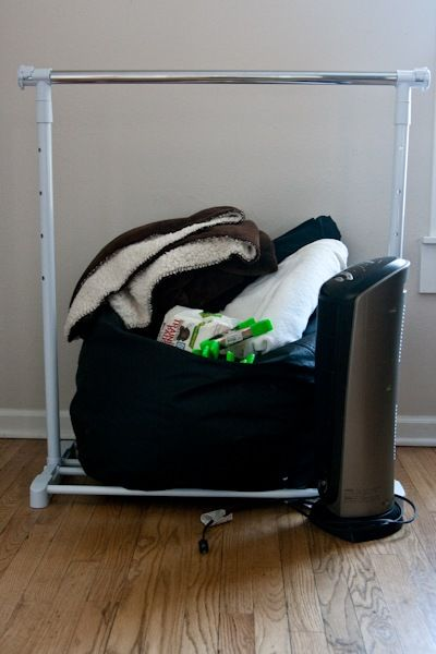 Absolutely LOVE this newborn photo kit for under $70 ... clothing rack and blankets for backdrops, pins, beanbag chair, space heater, etc. Genius!