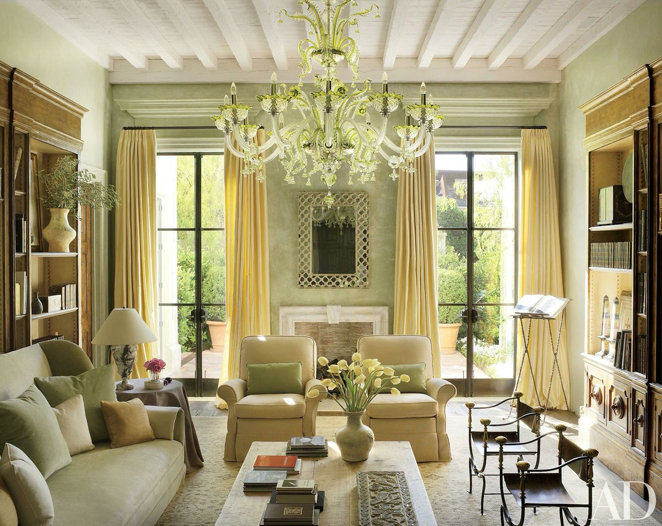 16 Stunning French Style Living Room Ideas: Living Room With A Beautiful Chandelier And French Doors