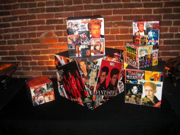 printed photos of popular magazines and music from 1981 - 1984.  attached to boxes and covered with packing tape.  perfectly square boxes can be purchased at Container Store.  HIGH SCHOOL REUNION DECOR IDEAS.