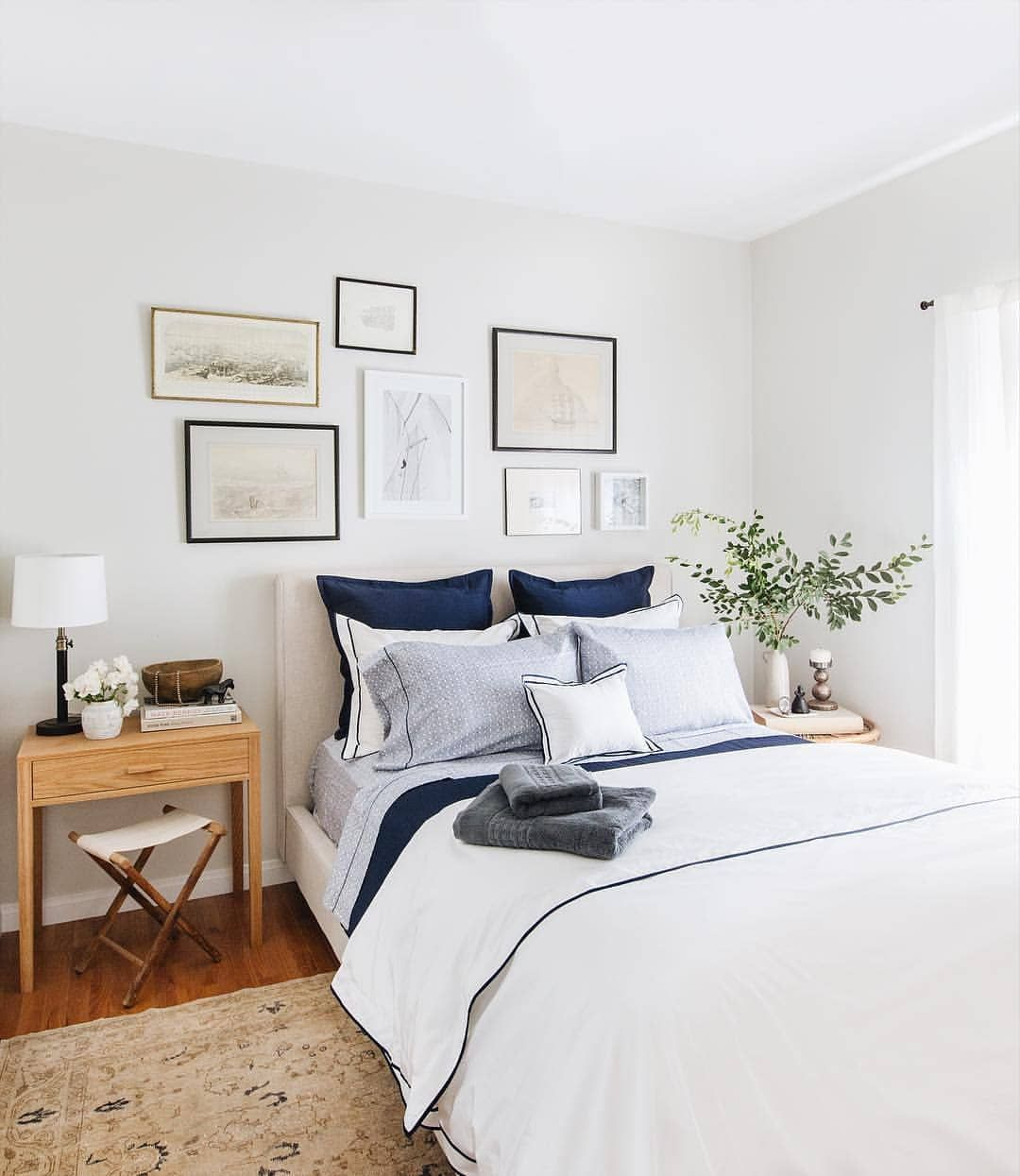 Navy And White Bedroom With Gallery Wall Above The Bed