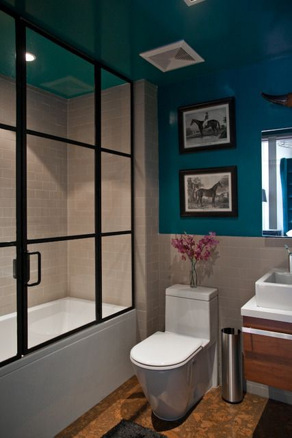 Apartment Bathroom Colors. In this bathroom  the tile and color lines upper wall ceiling while bottom is classic subway I love thick black frame on shower LA CA Home Design Small Space Big Style Apartment Therapy