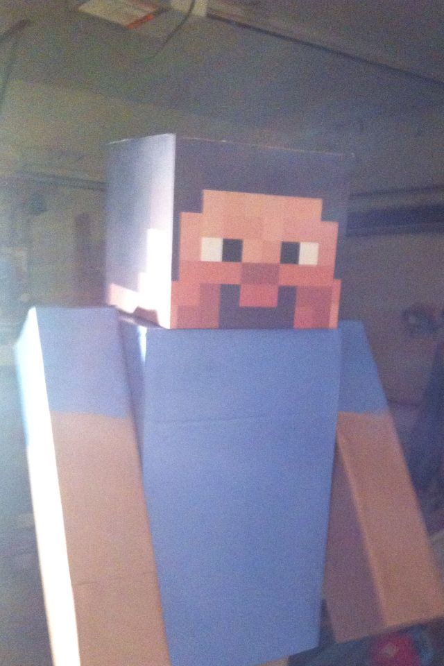 Minecraft Steve made out of boxes from Lowes, brown packing paper and spray paint.