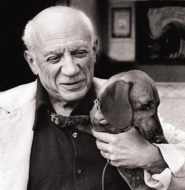 Pablo Picasso and his dachshund.