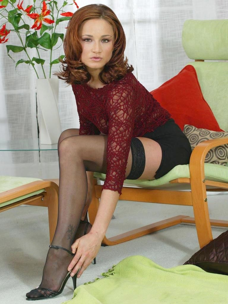 Boots stockings redhead was sitting
