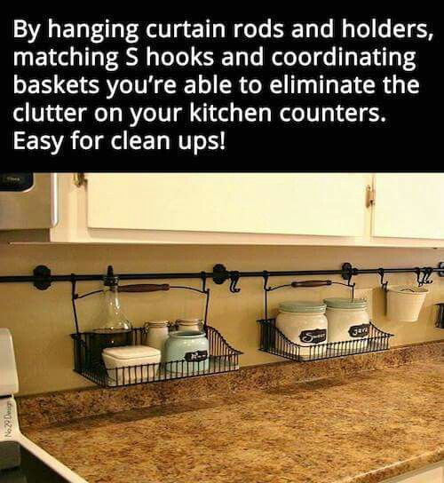 By hanging curtain rods and holders, matching S hooks and coordinating baskets you're able to eliminate the clutter on your kitchen counters.   Easy for clean-ups!