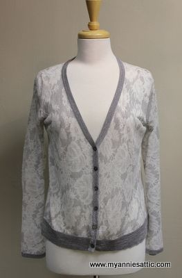 Chico's silver & white cardigan, size XS (0) Long sleeves, lace and floral print Ramie, rayon, polyester, nylon, metallic 6 buttons down the front $29.50