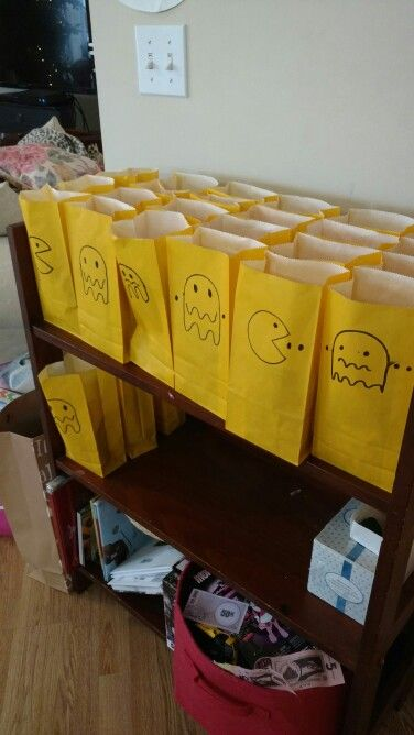Dollar store bags with drawn on pac man and ghosts with black marker.