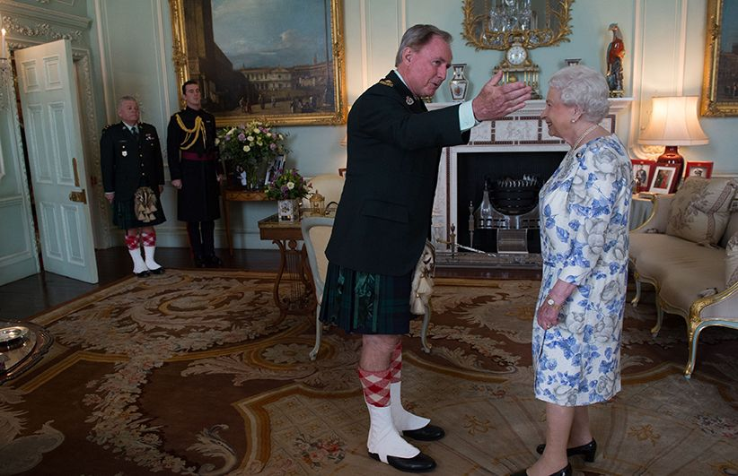 Queen Elizabeth II, in her capacity as Colonel-in-Chief of the Argyll and Sutherland Highlanders of Canada, receives Colonel Ronald Foxcroft (Honorary Colonel) at Buckingham Palace in London. (Stefan Rousseau/PA)