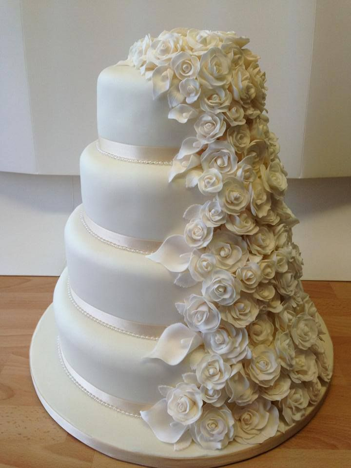 White Elegant 4 Tier Wedding Cake with Rose and Calla Lily Cascade and Pearl Detailing-  Beautiful!  https://www.facebook.com/photo.php?fbid=544371575601959=c845f72011