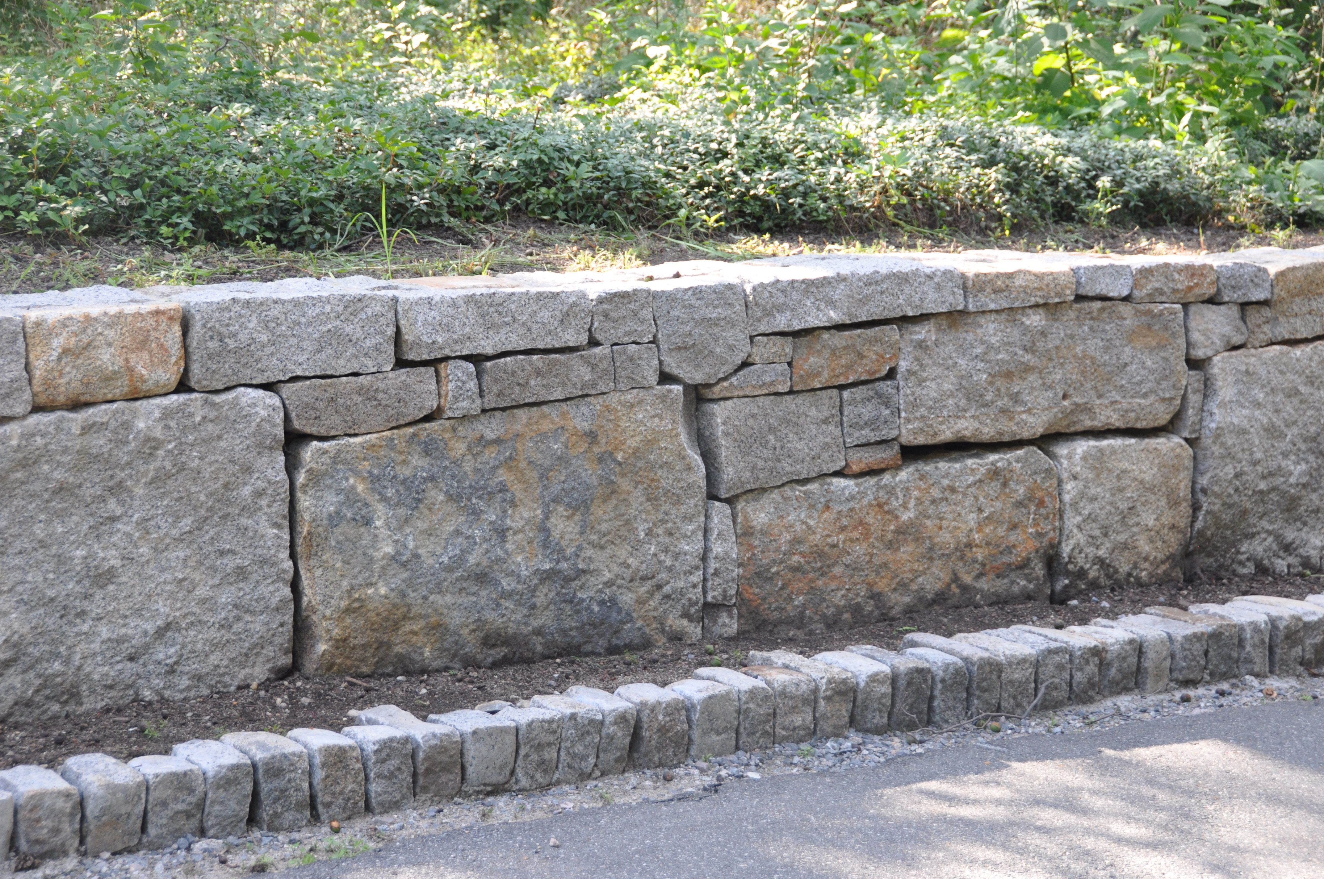 Building A Character Filled Wall With Reclaimed Granite Blocks Granite Blocks Landscape Design Stone Retaining Wall