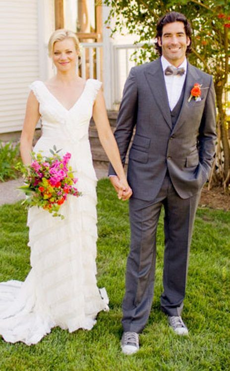 AMY SMART & CARTER OOSTERHOUSE: The beautiful couple were wed at their 13-acre Michigan farm. The table assignments were written on paper leaves and pinned to fresh apples.