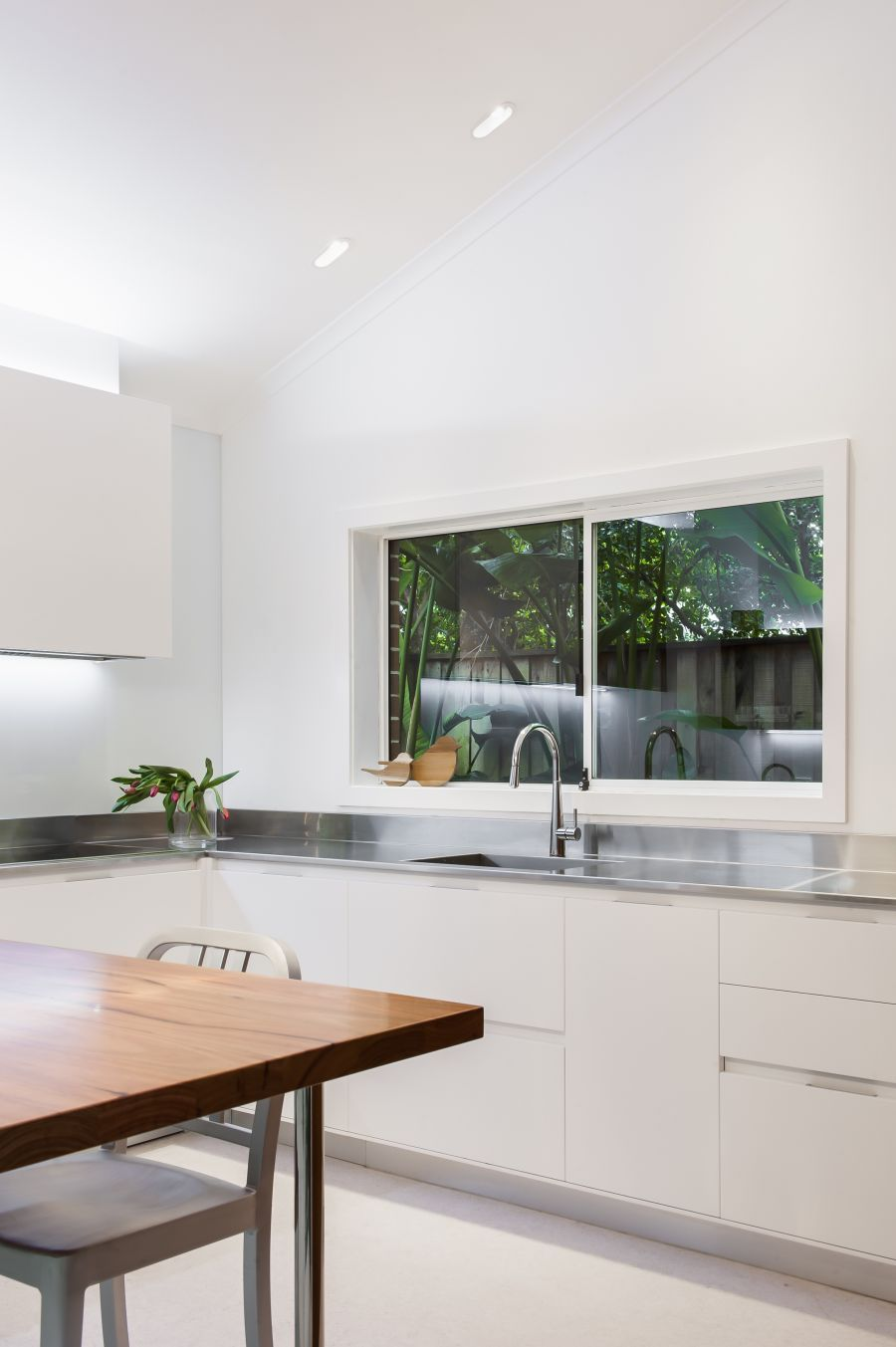 Small Contemporary Kitchen Makes Room For Home Office and Laundry ...