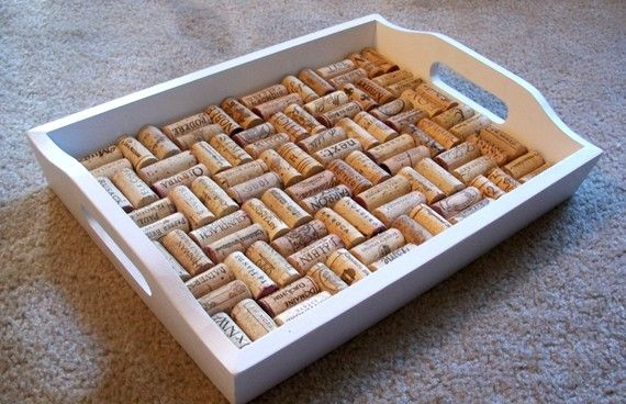 Corks Laid Inside A Serving Tray That Has Some Depth To It E G
