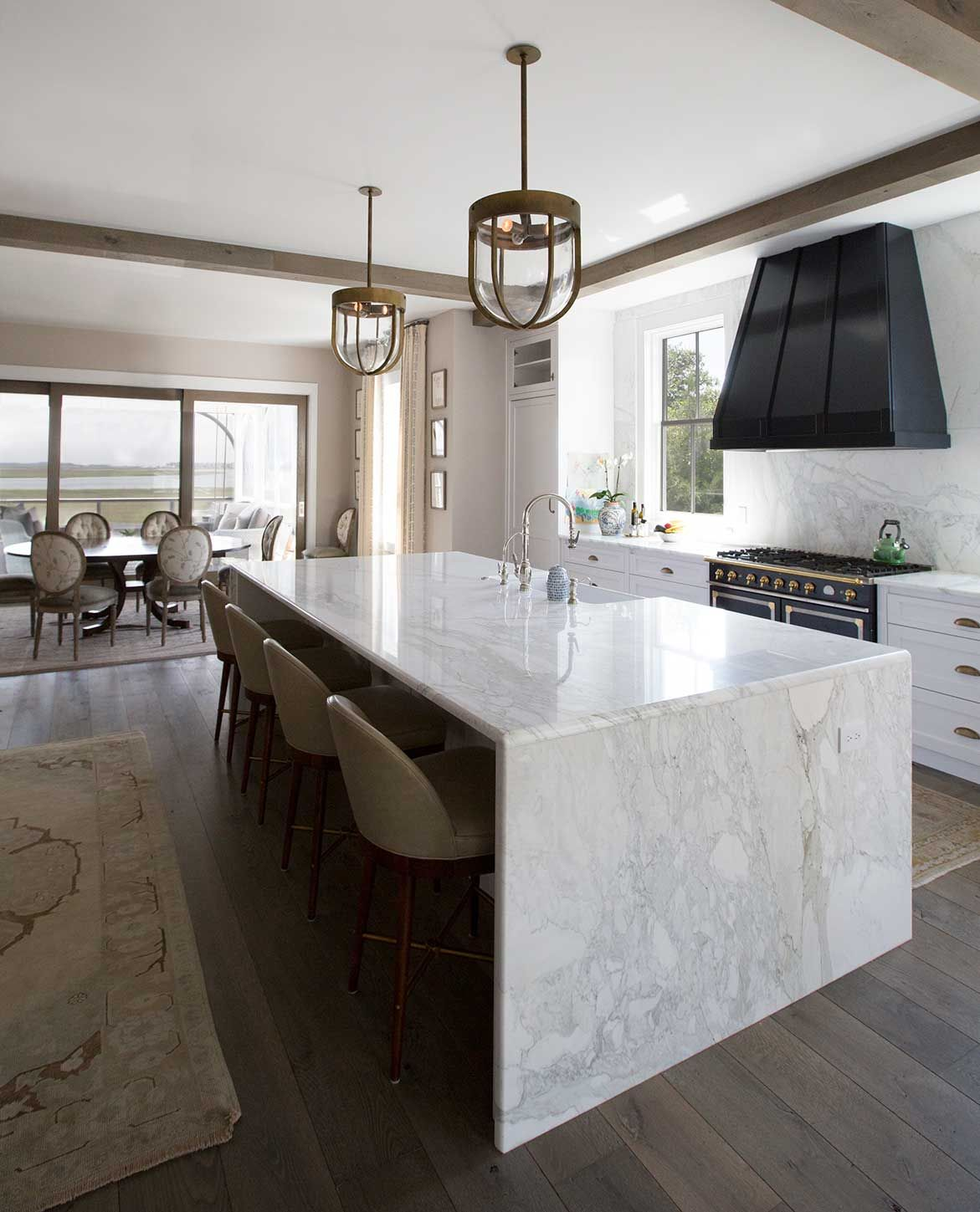 Marble Slab Island With Seating And Built In Sink Waterfall Countertop Kitchen Island Design Waterfall Island
