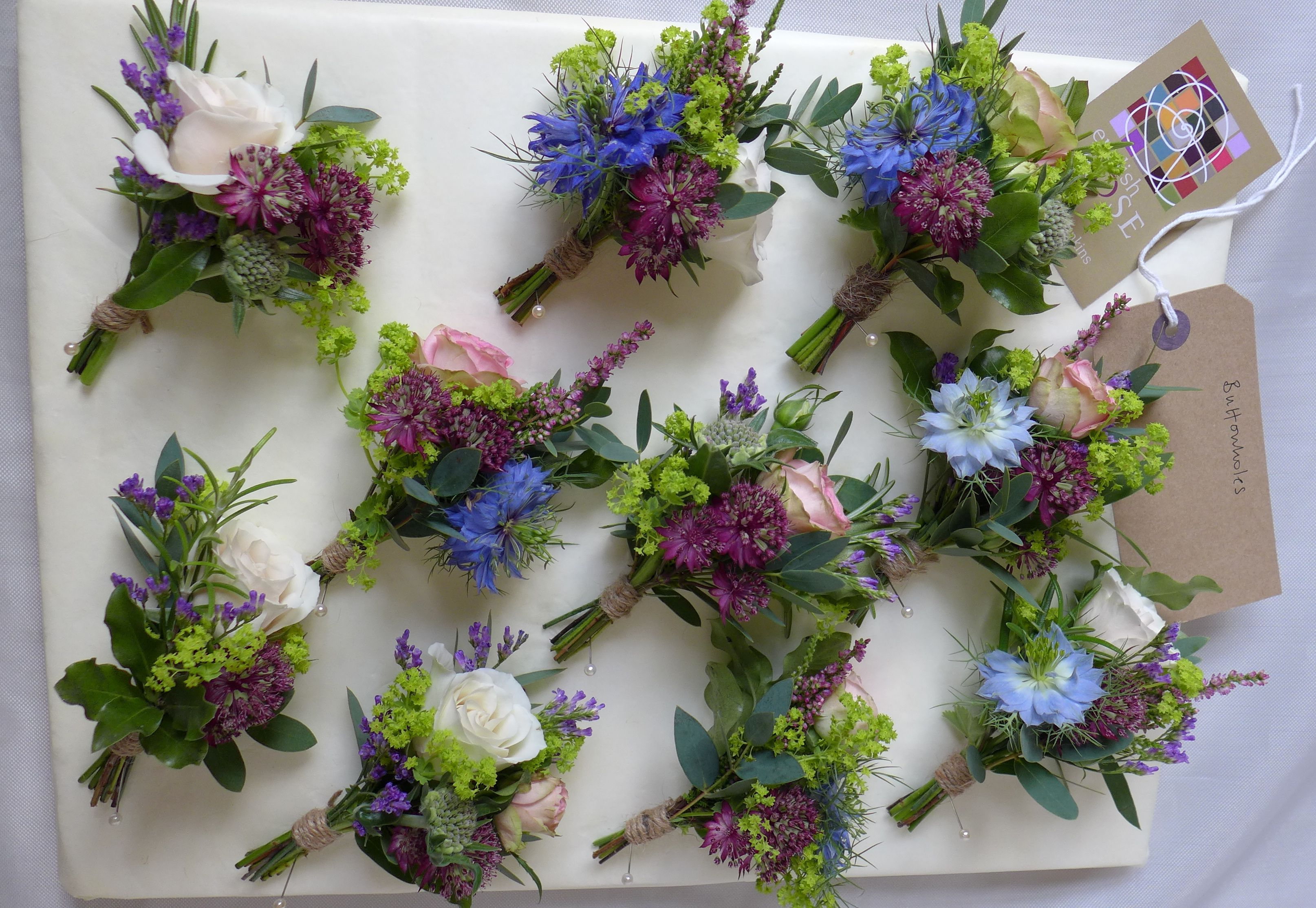 Natural country style buttonholes tied with twine