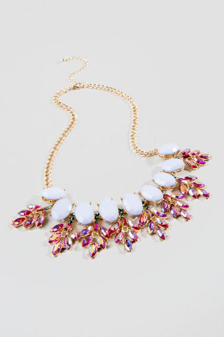 "The Reina Statement Necklace is the perfect addition to any formal dress!  Faceted lavender stones are accented with iridescent pink gems that lay in a leaf like spears.  Pair this with a dress & heels & be date night ready!<br /> <br /> - 17"" length<br /> - 3.5"" extension<br /> - Lead & nickel free<br /> - Imported"