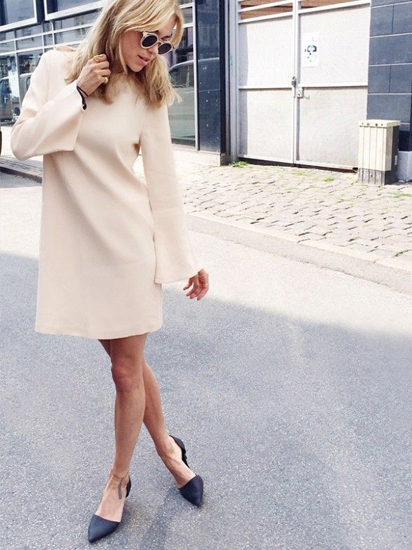 Pernille Teisbaek wears a neutral bell sleeve dress with sunglasses and ballet flats