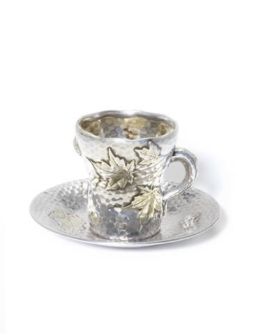 "A late-19th century American silver and silver-gilt coffee cup and saucer by Tiffany & Co., incuse stamped  ""5671  M 1293, Sterling silver 1230"""